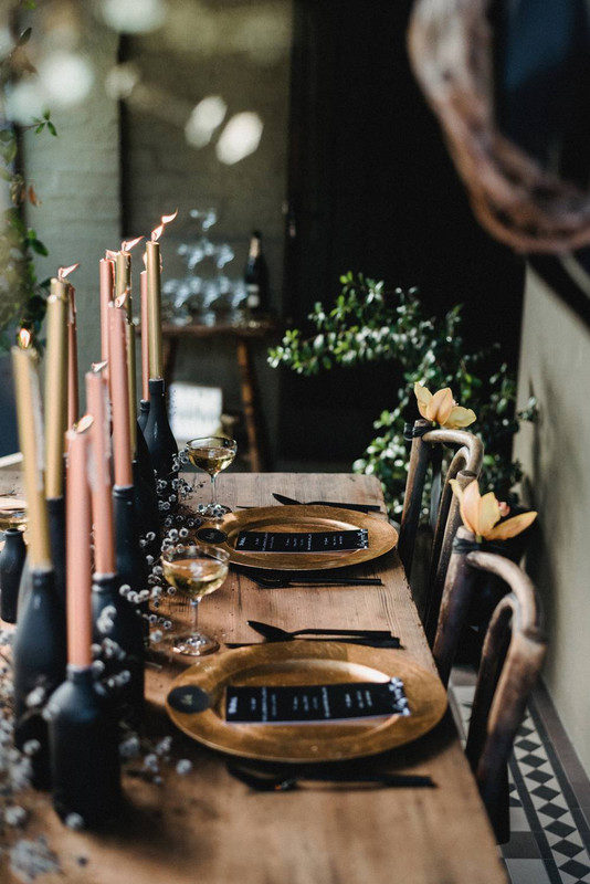 how-to-host-a-halloween-party-that-s-grown-up-not-gross-halloween-party-decor-pink-gold-and-black-dinner-party-tablescape-57d842f081c866970ee84ecf-w620_h800