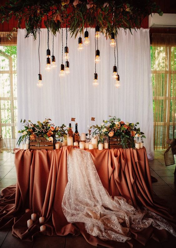 22-a-white-curtain-backdrop-overhead-blooms-and-bulbs-for-a-fall-wedding