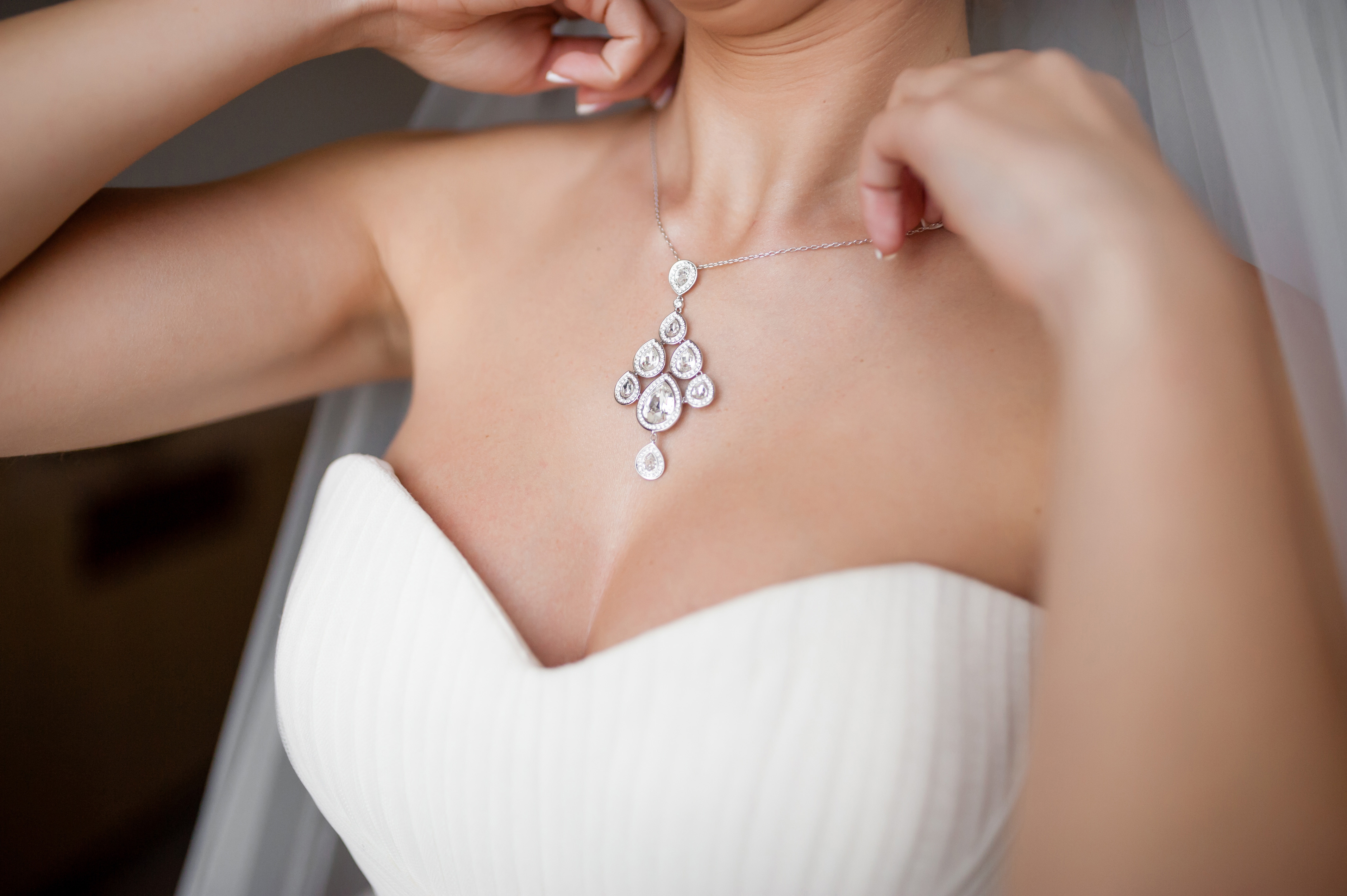 The bride wears a necklace.