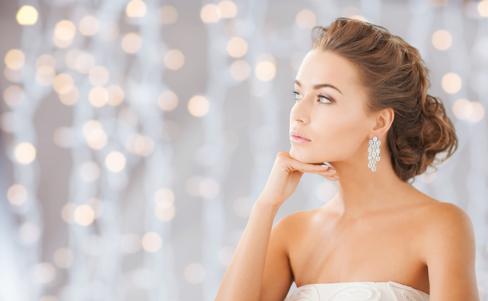 beautiful woman wearing shiny diamond earrings