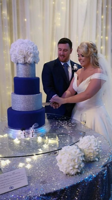 CAROLYNNE AND RORY CUTTING CAKE