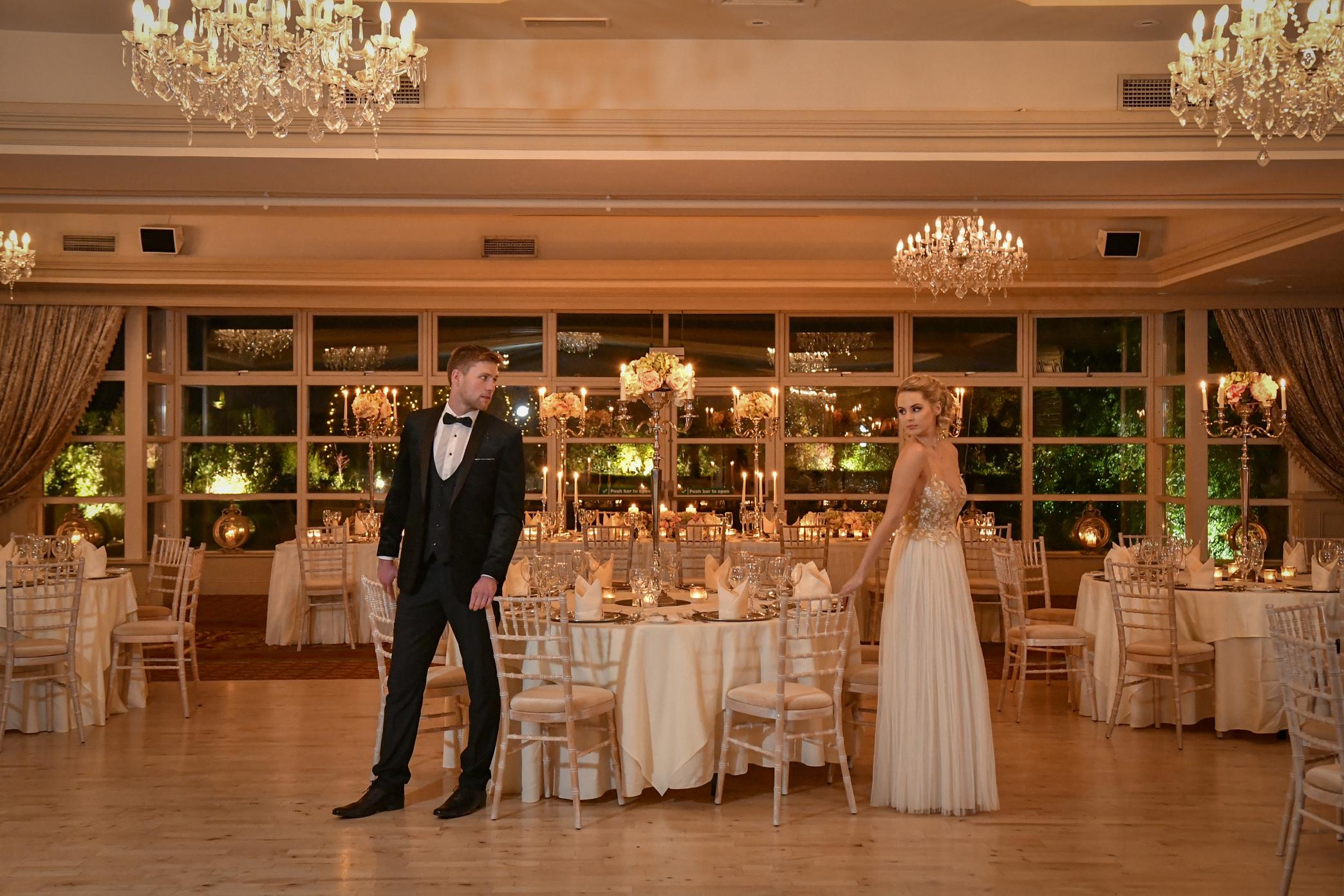 Bride & Groom in Candlelit Ballroom wide shot-min