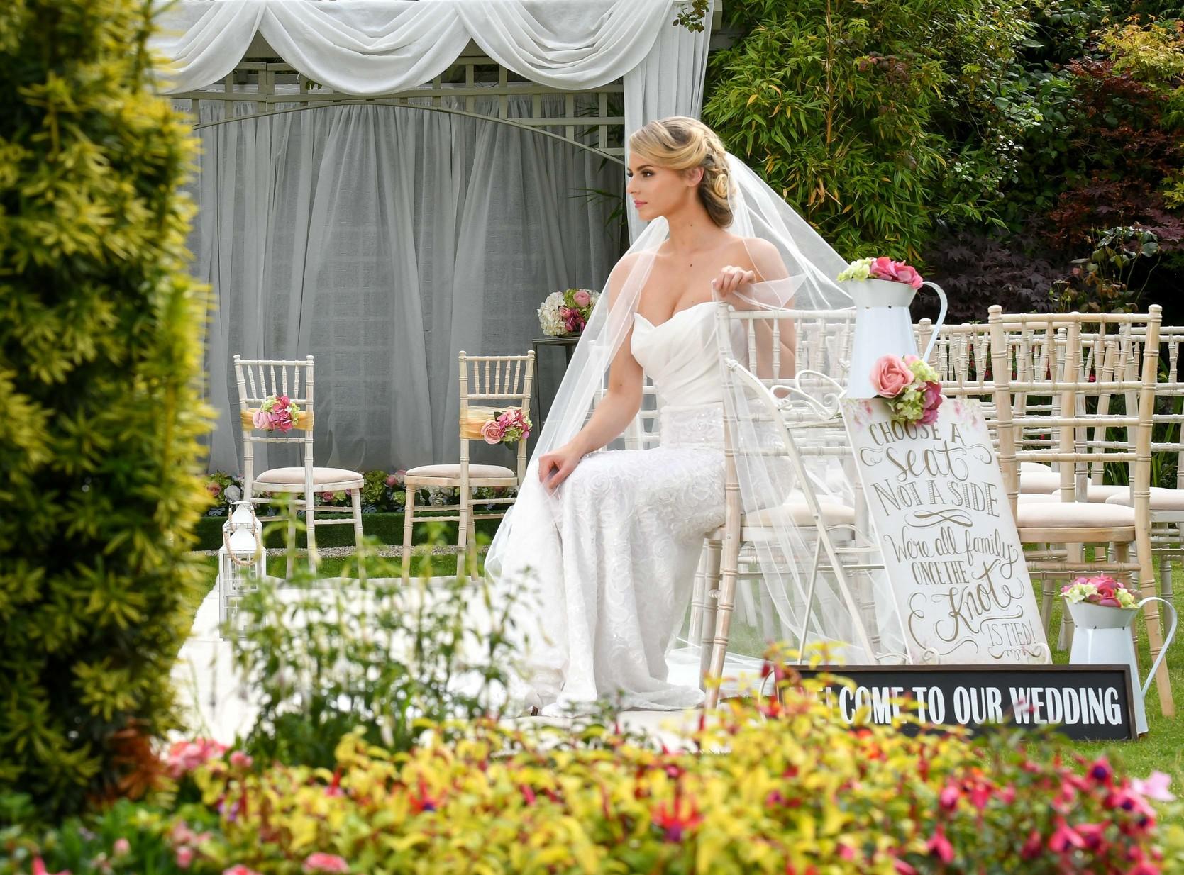 Bride in garden sitting for civil ceremony