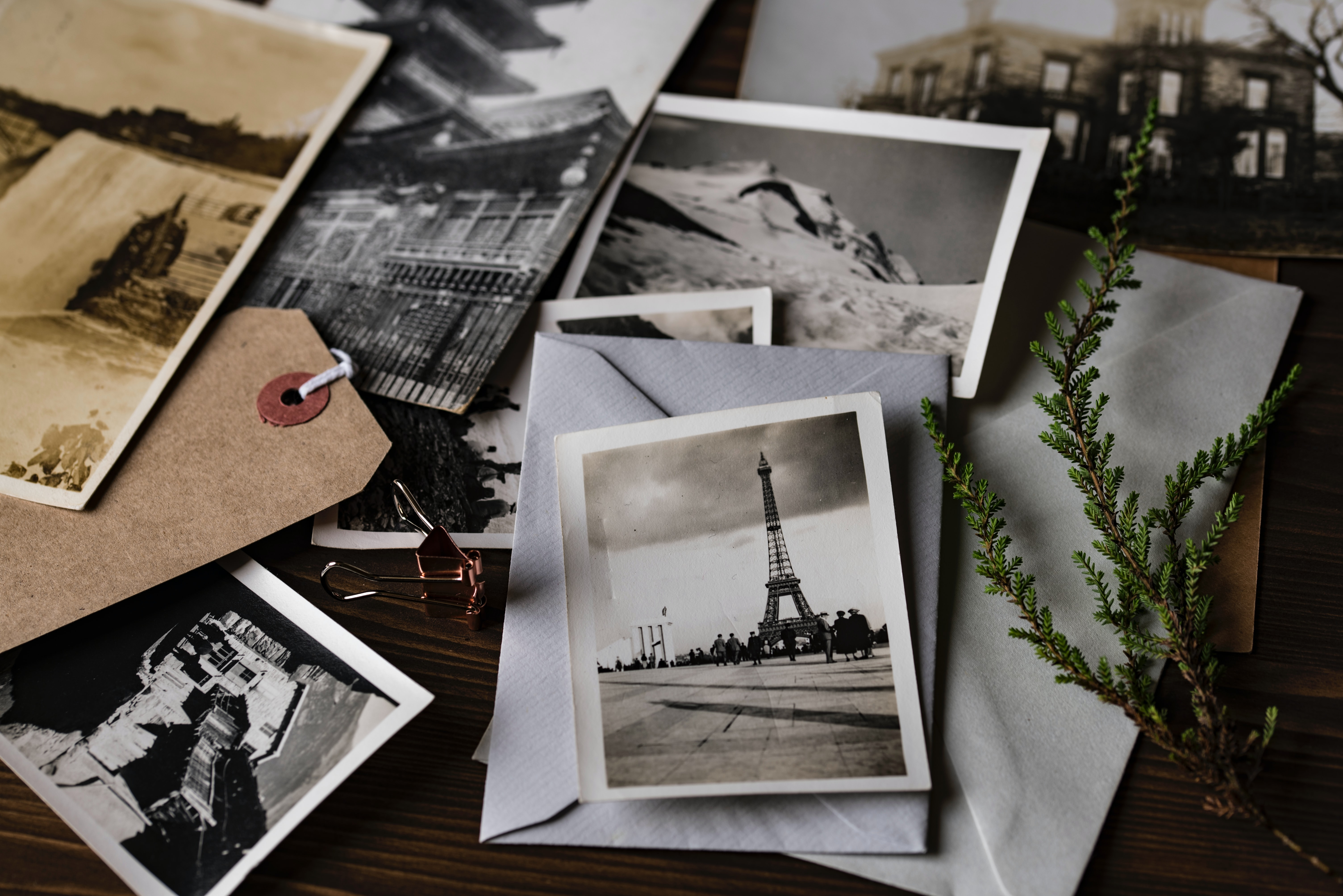 a pile of Old black and white photos